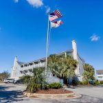 Beaufort Inn exterior with state and national flags